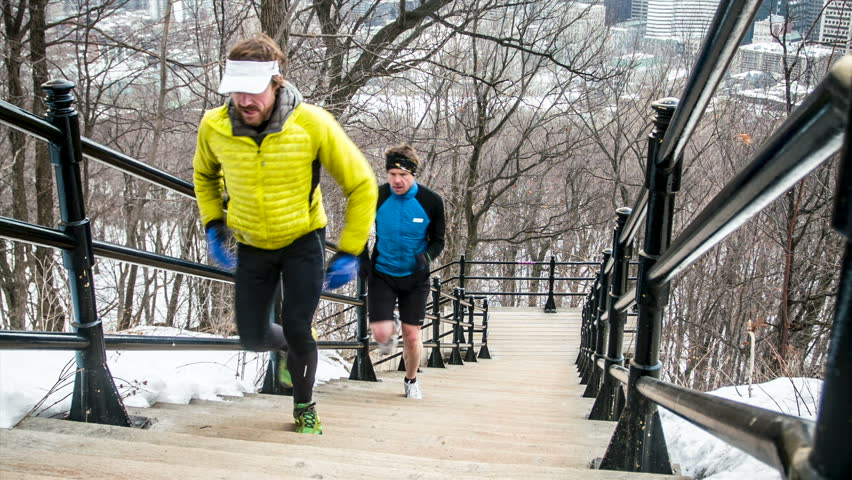 Male trail runners training on the Mount-Royal in the city of Montreal, Quebec, Canada. - HD stock video clip