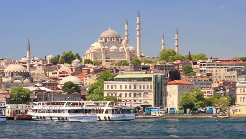ISTANBUL - MAY 1, 2012: Eminonu harbor with berthed passenger ships. Eminonu side is major travel and tourism center in the city. Istanbul old city from the waterside