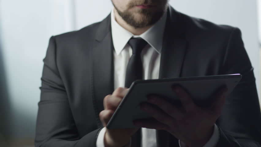 Businessman Using Tablet PC at Work