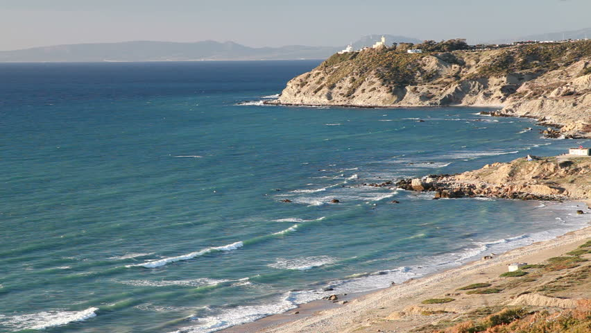 Atlantic Ocean coast with Lighthouse on the rock. Tanger, Morocco