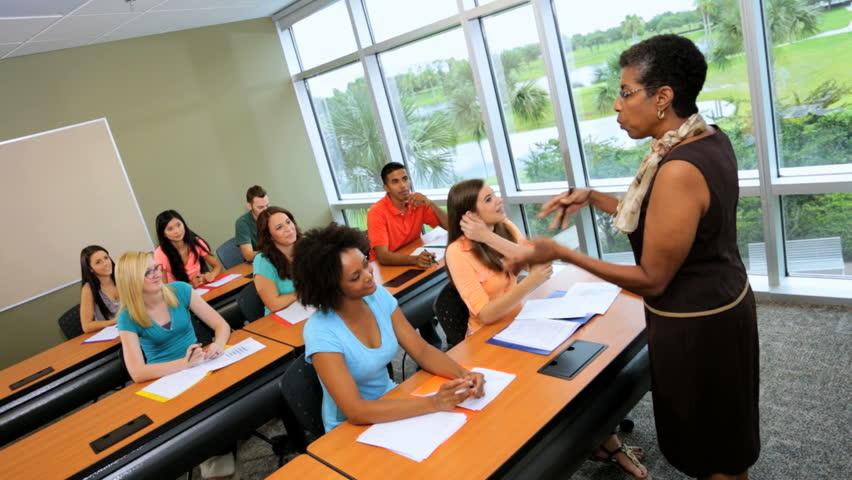 Modern Classroom Students : Teenage multi ethnic boys girls university it class in
