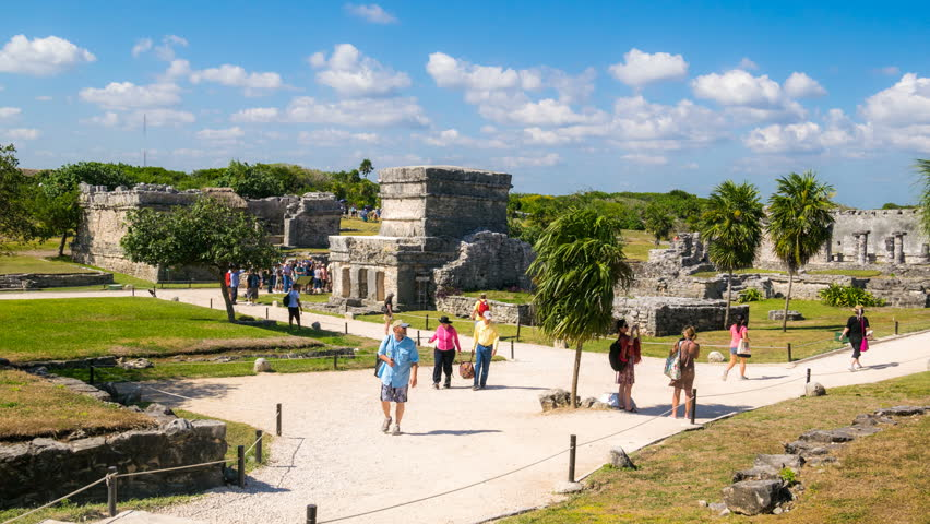 TULUM - 18 FEB: Timelapse view of Tulum ruins in the Yucatan in Mexico - a popular destination for tourists right by the water on 18 February 2014 in Tulum, Mexico