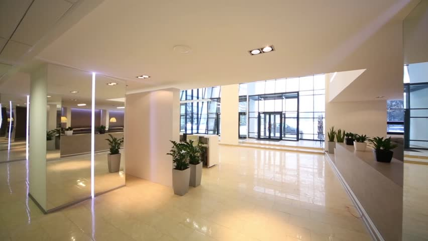 Spacious lighting empty reception hall in modern building