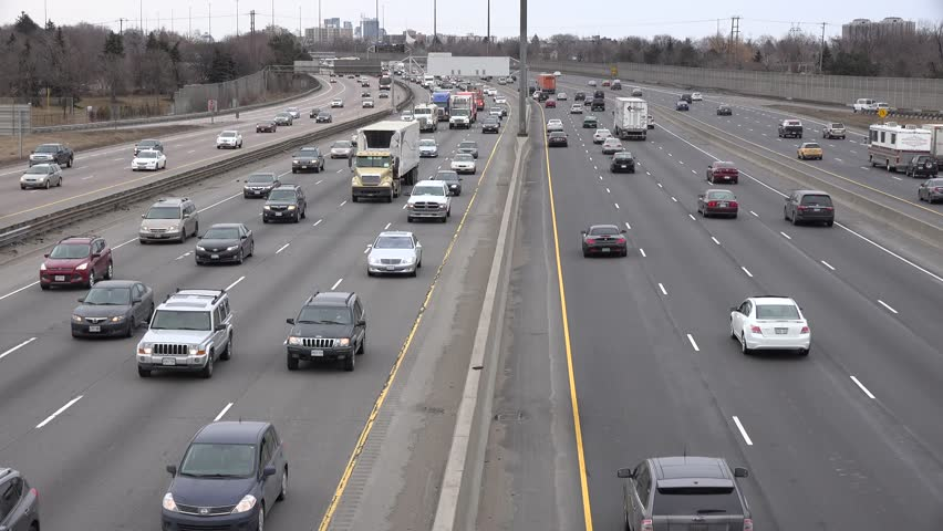 TORONTO,CANADA-APRIL3,2014: King's Highway 401. The segment of Highway 401 passing Toronto is the busiest highway in North America, and one of the widest and busiest in the world. - 4K stock footage clip