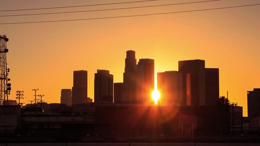 4K. Los Angeles city. Sunset over downtown LA skyline. Timelapse in motion (hyperlapse).