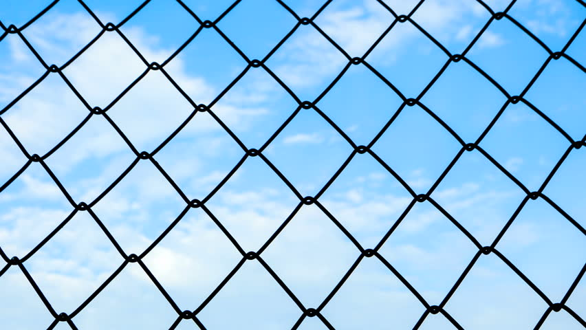 time-lapse of steel cage with blue sky and cloud moving in background - HD stock video clip