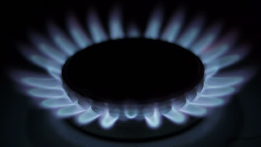 Flame of a gas burner in the kitchen stove gradually fading  - HD stock footage clip
