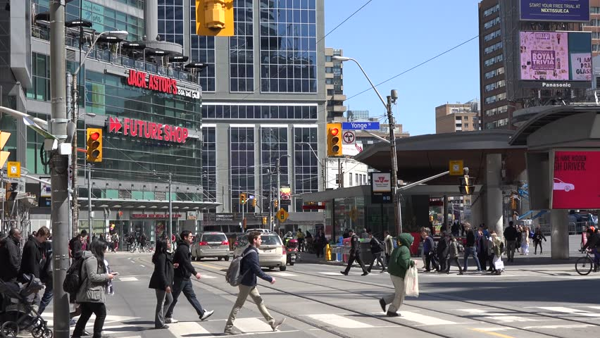 TORONTO,CANADA-APRIL 9, 2014: Outdoor scenes of the Eaton Centre and Dundas Square. There are 330 stores in the complex making the surroundings one of the busiest places in Canada.