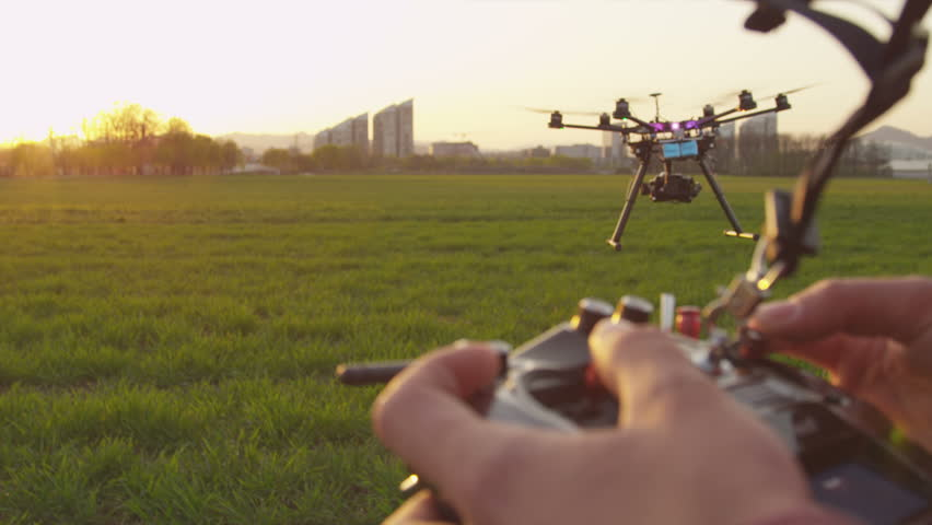 SLOW MOTION CLOSEUP: Drone operator holding a transmitter | Shutterstock HD Video #6095156