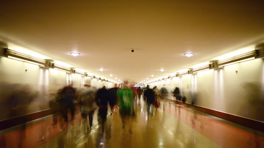 4K Time Lapse of Union Station Hallway with Commuters in Motion Blur -Tilt Down-