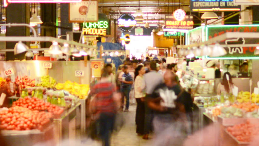 LOS ANGELES, California - April 9th: Time lapse Photography with zoom out motion of unrecognizable shoppers gather at historic Grand Central Market in Downtown Los Angeles on April 9th.