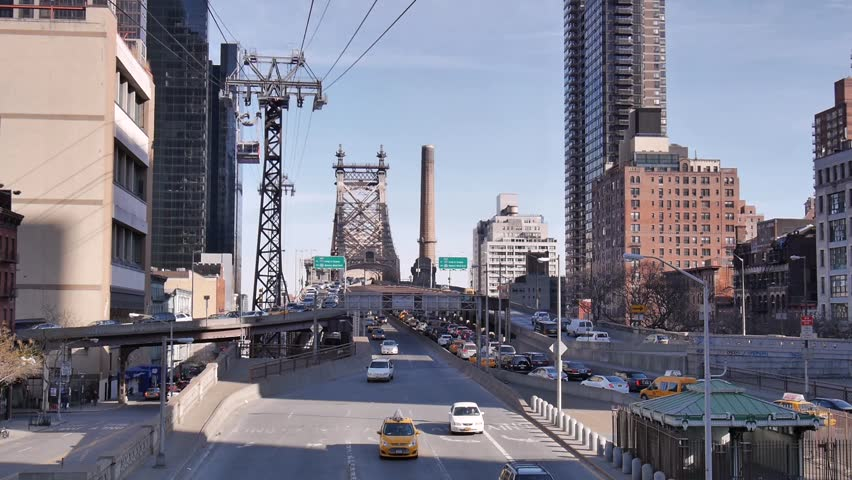 New York - March, 2014 - Wide shot of the Queensboro Bridge and Roosevelt Island Tram.