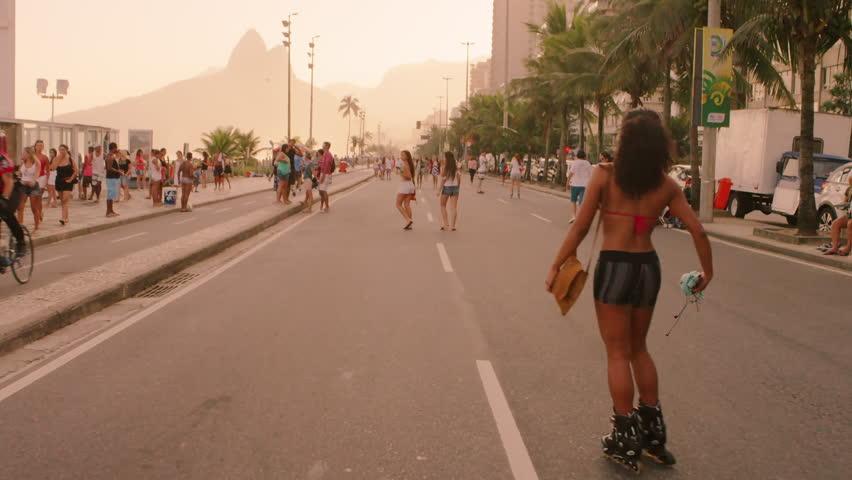 RIO DE JANEIRO, BRAZIL - JUNE: Slow motion tracking shot of Brazilian girl