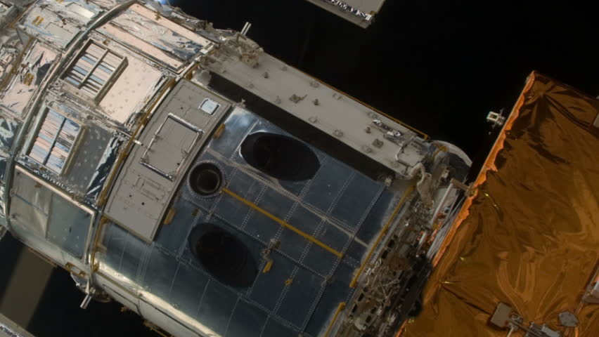 Hubble Space Telescope lifted out of the payload bay of the Space Shuttle