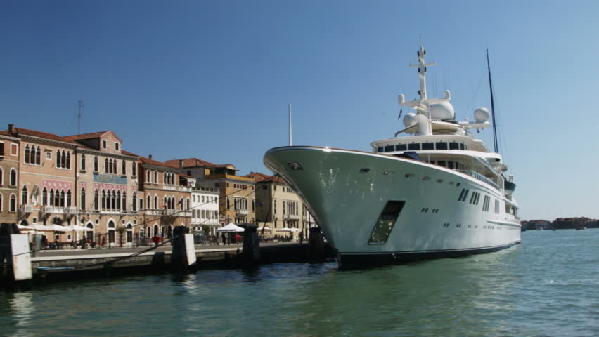VENICE, ITALY - APRIL 10, 2014: The yacht Tatoosh docked at Venice harbor. Tatoosh is owned by Paul G. Allen, co-founder of Microsoft - HD stock video clip