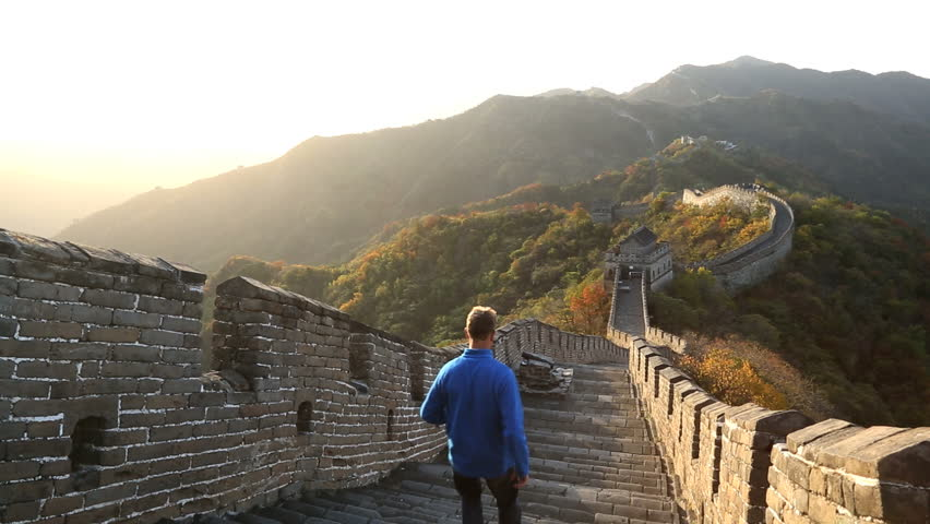 Great Wall of China male walking on the historic fortified wall between watch towers Mutianyu nr Beijing, China, Asia | Shutterstock HD Video #6167390