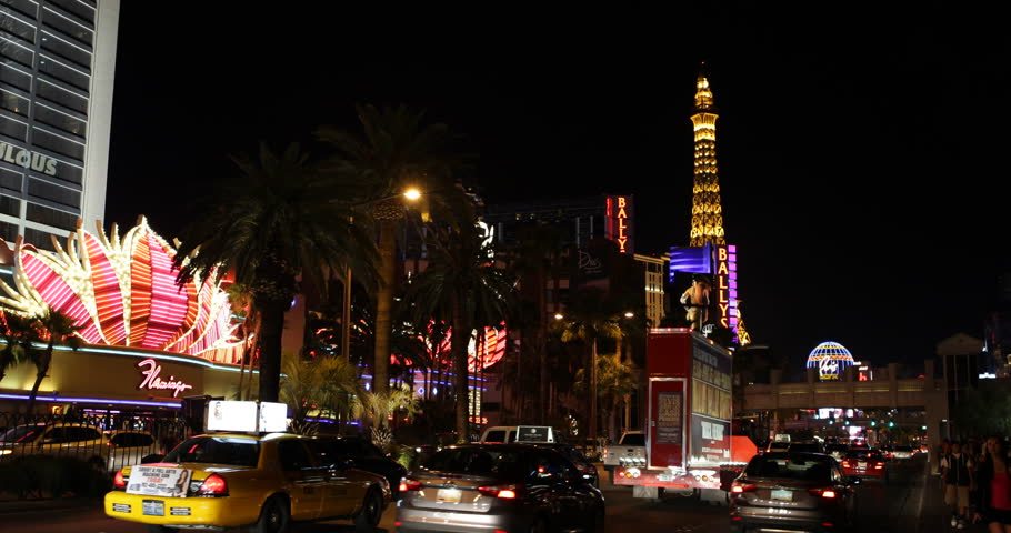 LAS VEGAS, USA - MARCH 29, 2013 Las Vegas Strip Boulevard, Eiffel Tower, Paris Hotel Nightlife, Crowded Traffic Flamingo Casino ( Ultra High Definition, Ultra HD, UHD, 4K, 2160P, 4096x2160 ) | Shutterstock HD Video #6175400