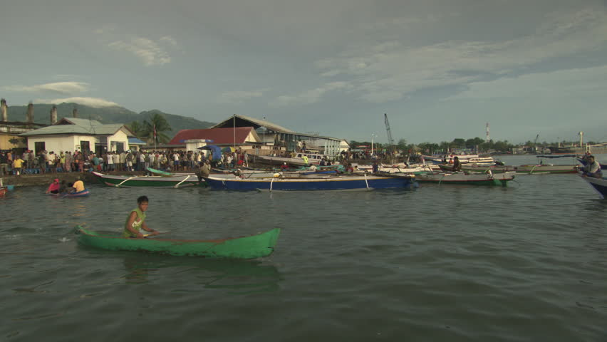 INDONESIA - CIRCA 2011 - Fishing boats in a harbour circa 2011 in Indonesia. - HD stock footage clip
