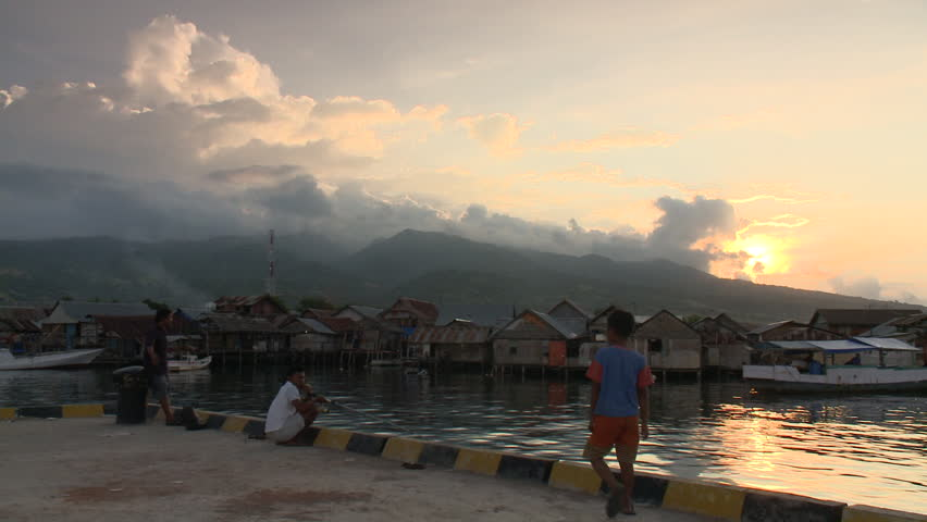 INDONESIA - CIRCA 2011 - Children in a village at the waterfront circa 2011 in Indonesia. - HD stock footage clip