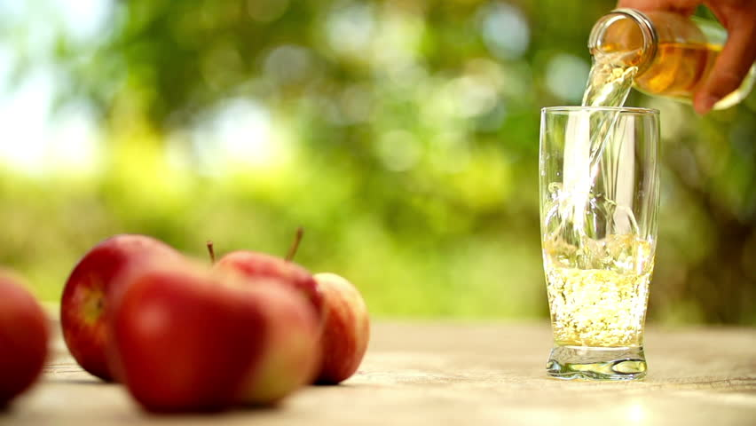 Guava Juice Slow Juicer : Ripe Red Apples With Glass Of Fresh Juice Being Poured In Slow Motion Stock Footage video ...