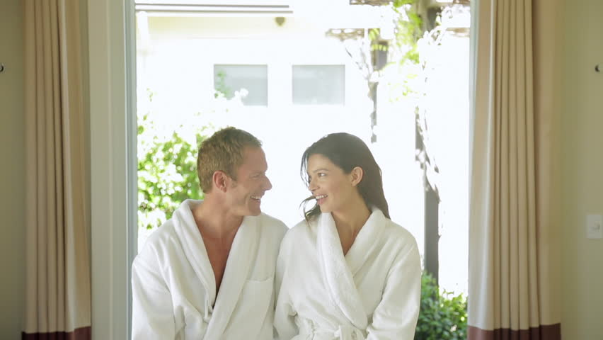 Romantic couple relaxing in their bathrobes at the spa after a massage together #6215738