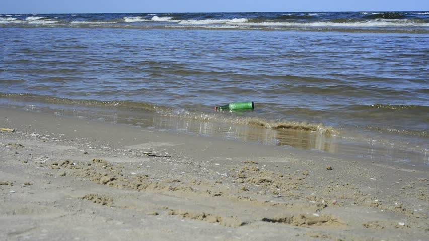 message in a bottle at a beach  - HD stock footage clip