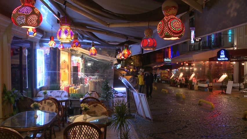 ISTANBUL, TURKEY CIRCA 2013 - Rain falls at night outside a cafe in Istanbul, Turkey. - HD stock video clip