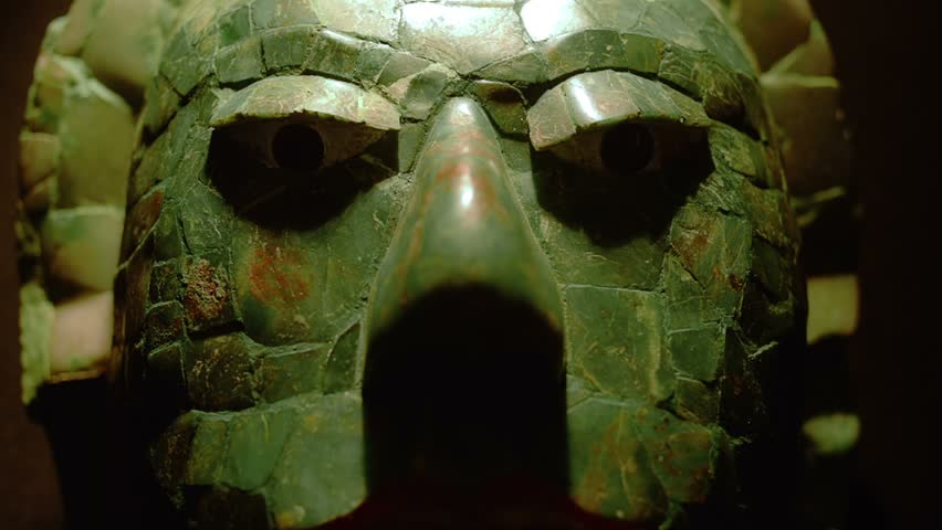 "MEXICO CITY, CIRCA JANUARY 2014: Detail of mask made in jade of a mayan warrior in exhibition ""Mayas Revelacion de un Tiempo Sin Fin"""
