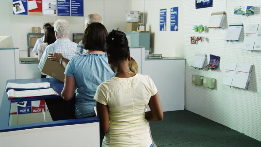 Medium Shot People waiting in line at post office