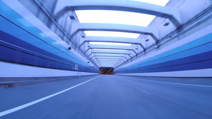 Twilight drive through Tokyo Bay Area's futuristic architecture through tunnels and highways.