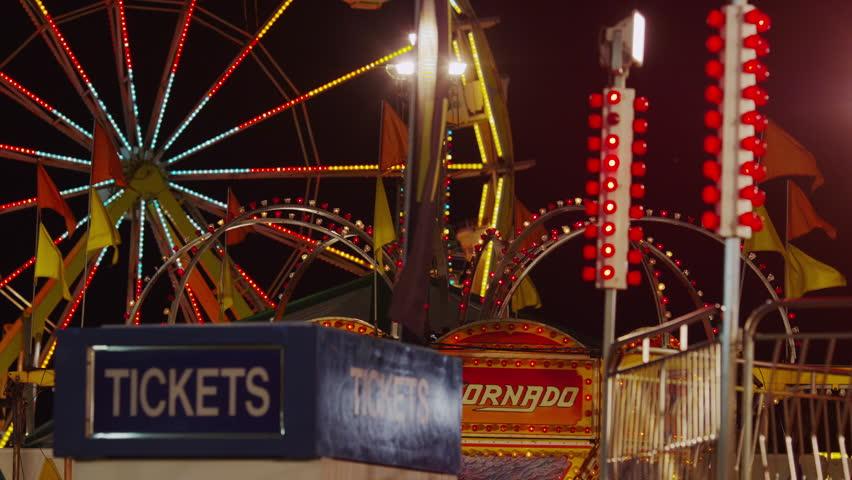 SALT LAKE CITY, USA - July 18, 2013 - Medium shot of Ferris Wheel and amusement park at night  - 4K stock footage clip