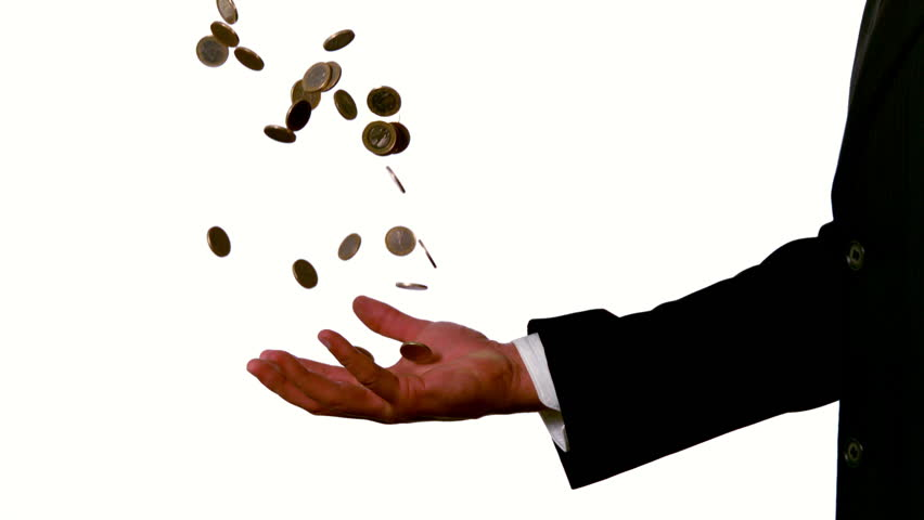 Businessman catching falling coins in hand in slow motion