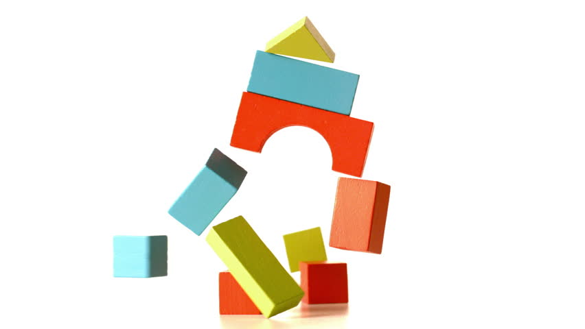 Building Falling Over : Building blocks falling and bouncing in slow motion stock