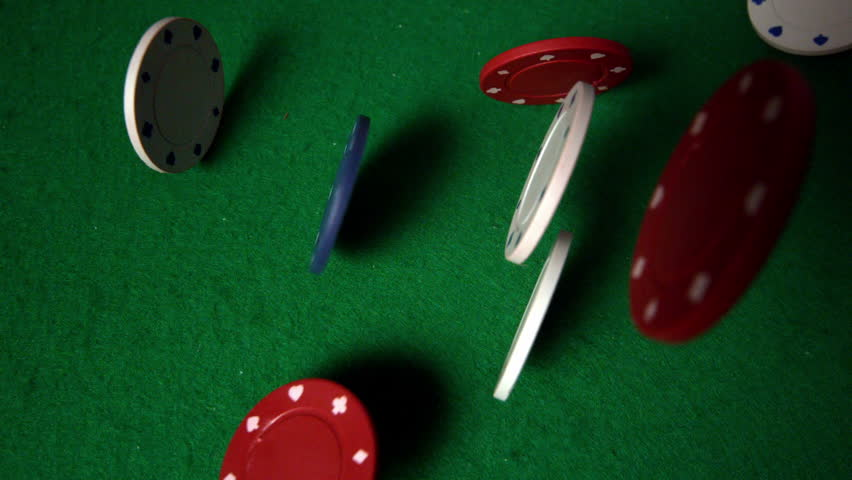 Many chips falling on casino table in slow motion