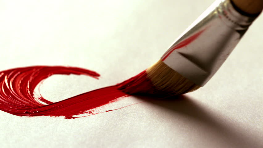 Painter painting with red paint and paintbrush in slow motion