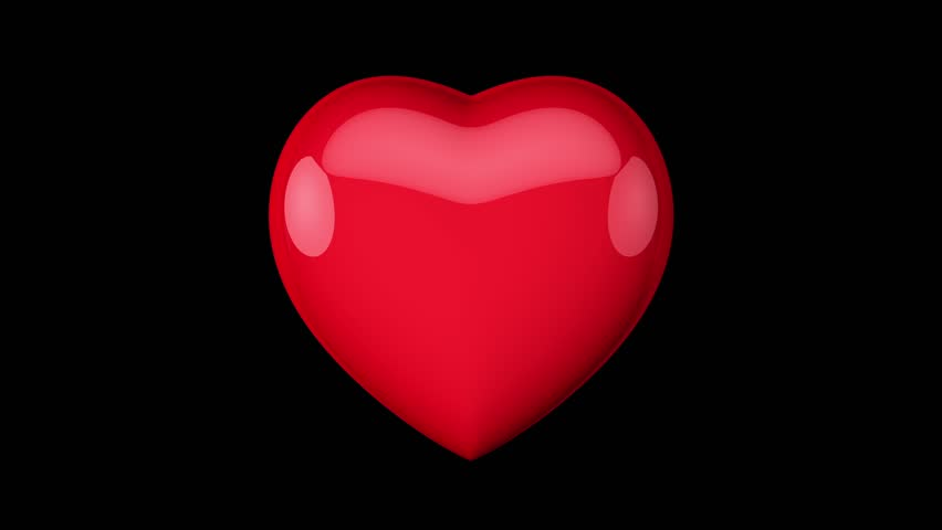 Pulsating Red Heart With The Light On An Isolated Black ...