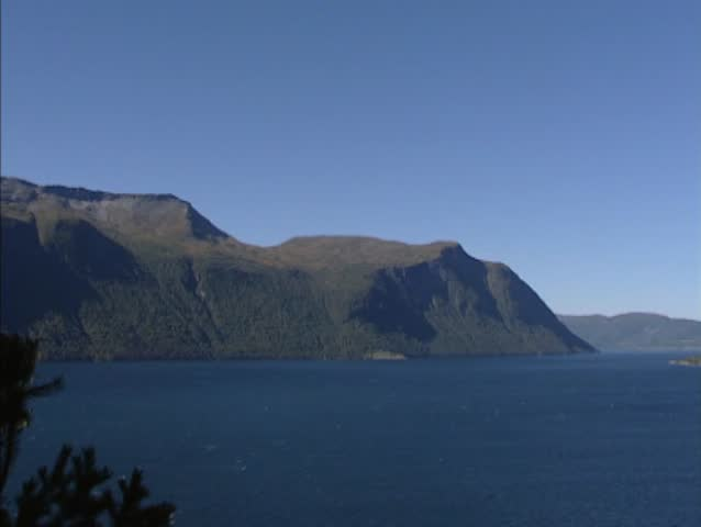 LANGFJORDEN, NORWAY: pan Fjord, U-shaped valley, created by mountain glaciers. When filled with ocean water so as to create an inlet, these valleys are called fjords. - SD stock footage clip