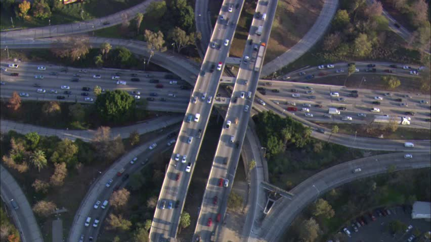 Los Angeles California Downtown. The skyscrapers and business district of downtown Los Angeles, California. The high view depicts a highway in the middle of the busy city. - HD stock footage clip