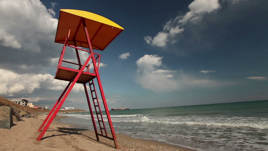 Lifeguard watching tower with chair.   Shutterstock HD Video #6457244