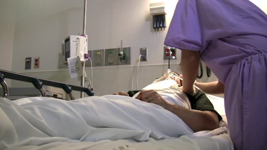Nurse taking care of patient  - HD stock video clip