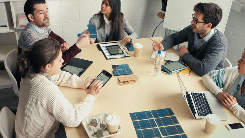 Young business people discuss solar panel energy concept - HD stock video clip