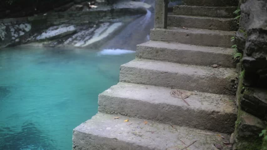 Lagoon of crystalline water aside of a stairs entrance - HD stock video clip