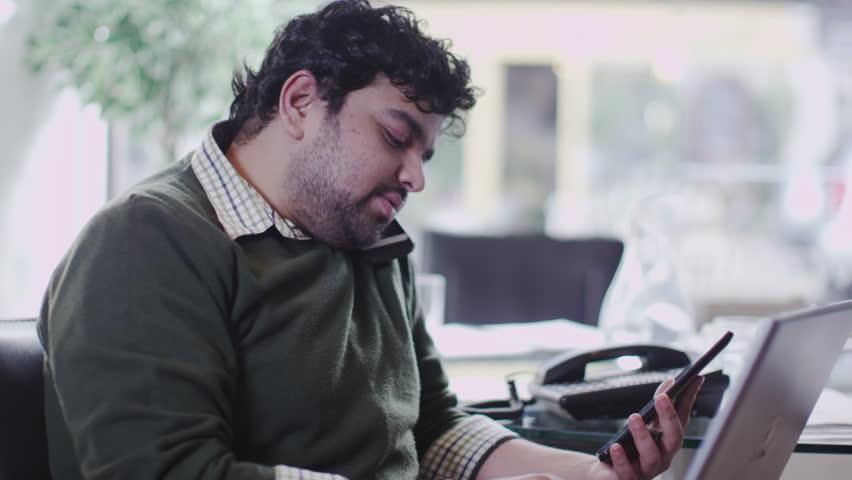 Man on phone in office | Shutterstock HD Video #6495206