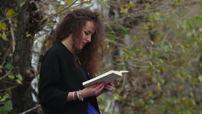 Girl reads captivating book, old school, traditional technology