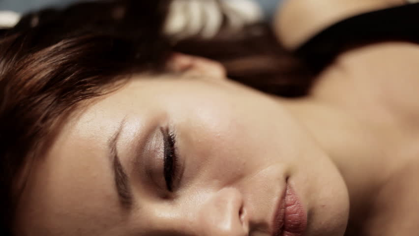 close up of the face of a beautiful young woman - HD stock footage clip
