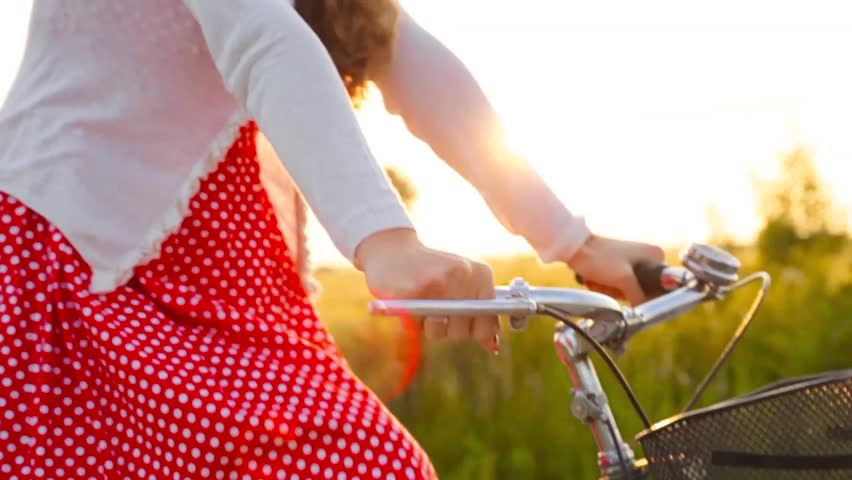 Happy Joyful Young Woman Riding Bicycle at Sunset Nature