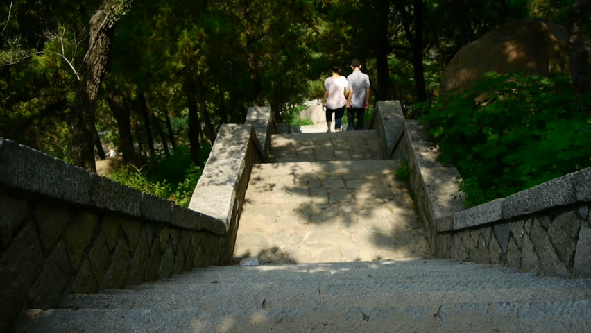 MOUNTAIN TAI,CHINA - AUG 17, 2013,Tourists walking in mountain stone steps,vines wrapped around arch door,Chinese ancient building arches. gh2_02366