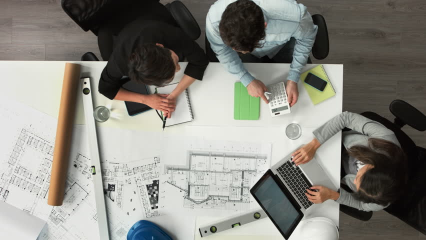 Architect plans arial view business meeting showing teamwork young diverse startup