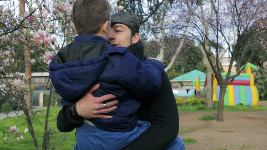 happy father embrace his son and play like carousel with him. dad, child, park - HD stock footage clip