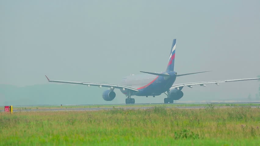 NOVOSIBIRSK, RUSSIA - SEPTEMBER 13, 2013: Jet airliner taxiing to the runway.  Spotting at airport Tolmachevo, Sep.13, 2013, Novosibirsk, Russia. Spotting organized press service of Tolmachevo airport - HD stock video clip